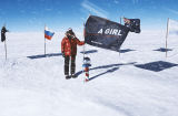 Mountain climber at the south pole holds the