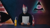 A man wearing a clown mask sits in a news studio with two bottles of Granini lemonade.