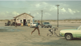 A man chases a robot